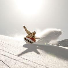 Wolfgang Nyvelt riding one of his Asmo Powder Surfer.  no bindings = more fun  #snowboarding #powder