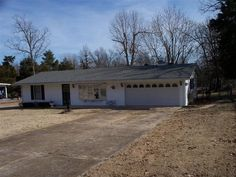 """Newer 3/4"""" T&G Oak flooring & quarter round, new paint, newly remodeled ½ bath, new custom shades in living room, new electric fireplace, new ceiling fan in living room, in-wall TV outlet for BR, new kitchen sink, faucet & filter in 2014. Newer Ht & Air, roof, garage door opener & siding. Nice fenced yard in Mountain Home AR"""