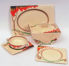 """A Clarice Cliff extensive Dinner Service, all decorated in colours with the """"Taormina"""" design, all in Biarritz shapes, comprises two rectangular Lidded Tureens, three graduated rectangular Platters, a set of six two-handled circular Soup Bowls on stands and twelve rectangular Plates in sizes, all decorated with shoulder patterns only"""