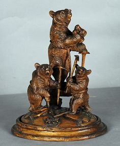 carved wood mountain climber bear with cubs. swiss brienz ca. 1890