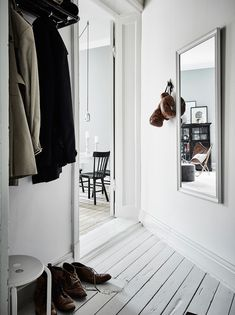 Scandinavian hallway interior design - big mirrors. For hallway decorating ideas, visit: https://nyde.co.uk/blog/decorating-a-hallway/