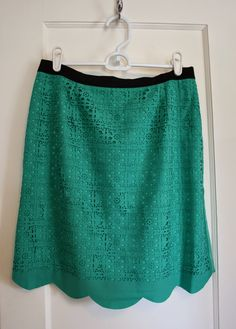 Love this skirt: the color, the lacy pattern, the scalloped edge. Perfection