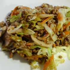 Asian Ground Beef Stir Fry  2 tablespoons of grapeseed oil  1 lb of ground beef  1 small onion, finely chopped  1 lb of thinly sliced mushrooms  ½ cup of shredded carrots  1-2 cups of shredded cabbage   2 tablespoons of gluten free soy sauce (coconut aminos works too)  1/2 tsp garlic powder  1 tablespoon fresh grated ginger