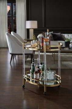 From our new Beverly collection: this glamorous bar cart on casters knows how to work the room with class--and a glass or two. #barcarts #entertaining