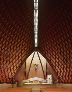 "French photographer Fabrice Fouillet has made a series of photographs called ""Corpus Christi"" in which he exposes the interior architecture of modern churches he visited during his travels."