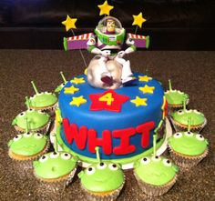 Toy story buzz lightyear cake with toy story alien cupcakes