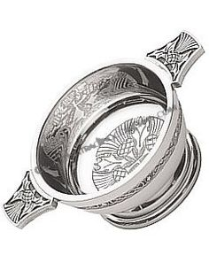 """The Highland Quaich - The Cup of Friendship. The word """"Quaich"""" is derived from the Gaelic word """"Cuach"""" which means """"shallow cup"""" or as we know it today, a """"drinking cup"""". The Quaich originated in the Scottish Highlands centuries ago and became the favourite drinking cup throughout Scotland. Traditionally, the Quaich is used when offering a guest """"the cup of welcome"""" and again when offering the farewell or parting drink. The cup is a simple, shallow bowl with two handles or ears, colloquially…"""