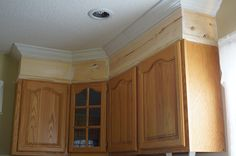 The easy way to attach crown molding to wall cabinets that don't ...