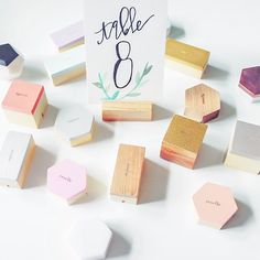 Geometric place card holders available on www.esselleSF.com  Signage by @FlyOverDesignCo    #placecards #cardholder #namecards #escortcard #signage