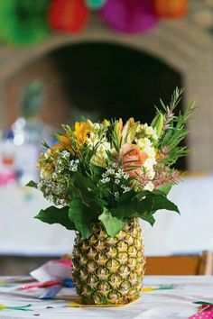 Flower arrangement in a pineapple - perfect for a tropical celebration!