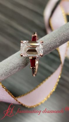 This baguette diamond ring is adorned with 2.04 ct. emerald cut diamond at the center. Embellished with two tapered baguettes shaped ruby on either sides of the center diamond, the engagement ring is an absolute masterpiece. #fascinatingdiamonds #diamondring #ring #threestonering #rosegoldring #engagementring #womensjewelry #diamonds #ruby Trinity Ring, 3 Stone Engagement Rings, Baguette Diamond Rings, Best Diamond, Emerald Cut Diamonds, Three Stone Rings, Women Jewelry, Rose Gold, Emerald Cut Diamond