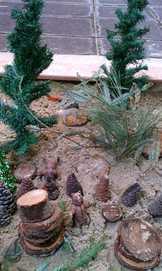 Our creative younger pod added a festive forest to their little sandbox on their patio. They supplied mini trees, real tree branches,. Outdoor Play Spaces, Outdoor Fun, Outdoor Learning, Outdoor Activities, Mini Mundo, Sensory Garden, Sensory Play, Tree Study, Sand Table