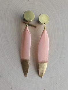 A personal favorite from my Etsy shop https://www.etsy.com/listing/605057767/light-pink-feather-with-gold-tip-plug