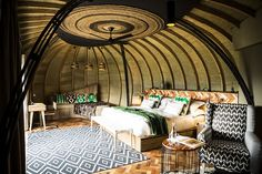 The Bisate Lodge is an eco-retreat in Rwanda designed by Nicholas Plewman Architects, featuring 6 pod-like villas surrounded by 103 acres of lush forest. Volcano National Park, National Parks, Villas, Gorilla Trekking, Stunning View, Elle Decor, Best Hotels, Beautiful Places, Interior Design