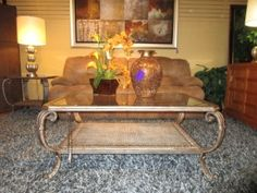 """49623  Metal coffee table with a glass top in a beautiful light bronze finish with elegant curved legs. There is one shelf at the bottom. At posting, there is a matching end table. 48""""long x 35""""deep x 20""""high."""