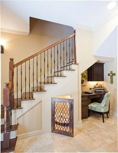 It is SO important that we use every inch of our house, otherwise your paying for wasted space. Here is a great way to fit in an office in the space under your stairs and a dog crate. Design by By Design Interiors. Under Stairs Dog House, Bed Stairs, Ramp Stairs, Attic Stairs, House Stairs, Rustic Staircase, Open Staircase, Dog Spaces, Traditional Staircase