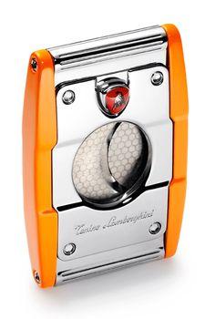 Tonino Lamborghini Precisione Orange Cigar Cutter Tonino Lamborghini Cigar Cutters Let its sharp dual guillotine blades cleanly slice your favorite cigar! Cigar Lighters, Cigar Accessories, Cigar Room, Cigars And Whiskey, Zippo Lighter, Cigar Smoking, Men's Wardrobe, Cigar Cutter, Lamborghini