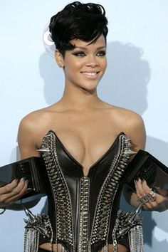 Rihanna Short, black hair with high, dramatic curls