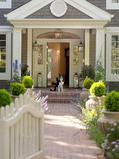 Charming front entry Topiary flanking entry