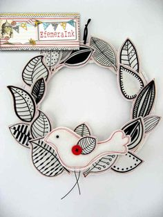 This is felt and could made with any shapes like holly with red berries and a white dove or a red bird.  Use a glue gun