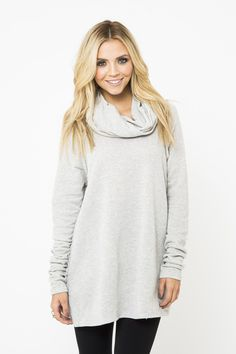 Chic and cozy, this oversized top features a cowl neckline, exposed raglan shoulder seams, and the perfect length to throw over leggings for a put-together look that's as comfy as your pajamas. 60% cotton, 40% polyester. Machine wash gentle, tumble dry low.