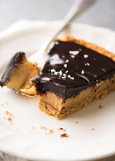 This tart has a biscuit crumb crust and is filled with a decadent, creamy salted caramel topped with ganache. Sinfully decadent, easy to make.