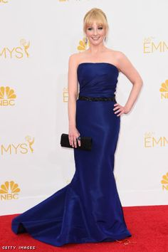 Melissa Rauch in a Pamella Rolan gown, Stuart Weitzman shoes, and a Judith Leiber clutch