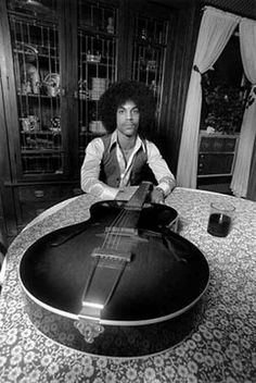 Early photo of Prince and a guitar