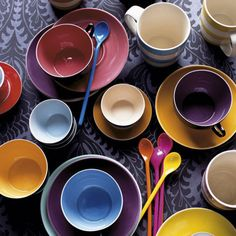 Tea cups - i love having mismatched dishes. why would you want all the same dishes? i wouldn't hang all the same stuff on my walls...