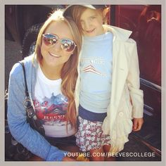 Proud Reeves College graduate posing for the camera with her daughter at the parade in Lethbridge, Alberta #proud #college #graduate #grad #camera #daughter #parade #Lethbridge #Alberta #AB #Canada #sunglasses #sunny #day #sunnyday #tshirt #collegelife #life #smiles