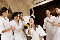 bride and bridesmaids. Such a fun pic of the Bride and her girls getting ready!