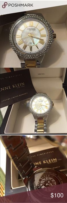 Anne Klein's Women's Watch 12-2155WMTT BRAND NEW Epitomizing contemporary elegance, this Anne Klein watch features the combination of Silver and Gold toned metal case and Swarovski Crystals. The white ceramic bracelet closes with a clasp of same tone of the band. The dial boasts Gold-toned Roman numerals and gold toned hands. For added elegance, the watch's Case is accented with dozens of additional Swarovski crystals. Other features include a genuine mineral crystal, and water resistance up…