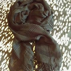 Black Textured Scarf *NWT* This black textured scarf is very versatile and can be paired with any outfit. The textured material can add a little something to any outfit that needs a kick without a busy pattern! New with tags, never worn! Accessories Scarves & Wraps