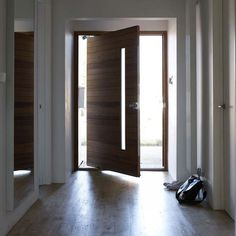 Hallway with oversized door. Consider Phantom Screens and start improving indoor air quality, enhancing home functionality and reducing cooling costs. House Front Door, House Doors, Porte Design, Pivot Doors, Cool Doors, Front Door Design, Modern Door, Entrance Doors, Front Doors