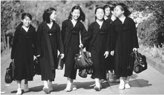 1950s North Korea - A group of North Korean girls walk to school. Education in North Korea is geared toward furthering the influence of state socialism.