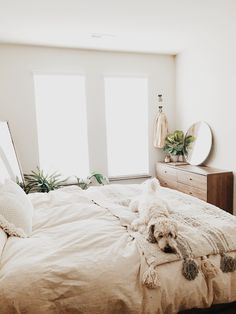 10 WAYS TO CREATE A COZY BEDROOM neutral, white bedroom with plants, wood furniture, and lots of natural light.plus a cute dog :] Source by yesthisismaddie. Cute Bedroom Ideas, Trendy Bedroom, Modern Bedroom, Natural Bedroom, Bedroom Inspiration, Bedroom Plants, Home Decor Bedroom, Design Bedroom, Bedroom Sets