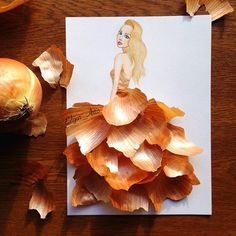 Amazing Paper Cut-out Dresses After you guys went crazy for the fashion…