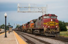 https://flic.kr/p/yvRcvr | The Cherry on Top | As the day draws to an end, an M-NTWGAL crawls into the receiving yard in Galesburg, Illinois with a more than stellar lashup. The train, even with it's multiple stops within the plants between the Barstow Subdivision connection and the yard, still managed to arrive before a massive thunderstorm started to hammer down.