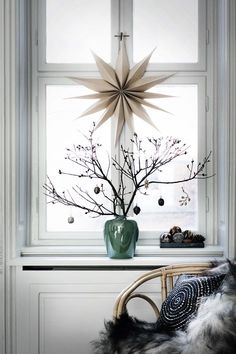 Nordic inspired Winter Window design. We love the 3D paper Star - simple yet effective for Christmas 2016.