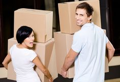 Back view of happy couple carrying pasteboard packages while moving to new house Stock Photo - 18500855 Self Storage, Storage Spaces, Moving Organisation, Organization, House Removals, Moving In Together, Cheap Storage, Moving Services, Organisation