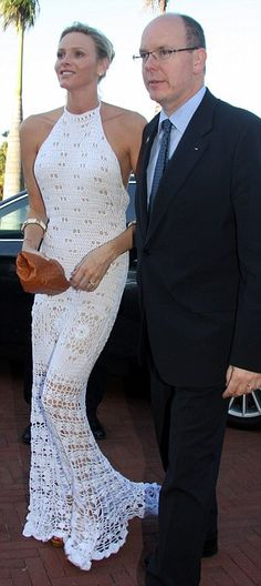 Full length white crochet dress worn by Charlene Wittstock during her honeymoon with Prince Albert of Monaco.
