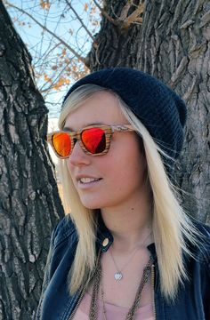 Zebra wood sunglasses in Flourish Red. One tree planted for each sale! www.thriveshades.com