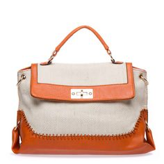 With intricate canvas weaving offset by divine faux-leather trim, Elida is a textured handbag with incredible allure.