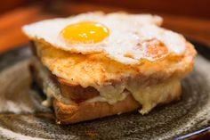 At its best a croque monsieur is a strong contender for the world's finest cheese and ham sandwich. It basically is a french gourmet version of the grilled cheese. There are very few ingredi…