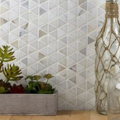 The hypnotic Aspekt Calacatta marble mosaic tile evokes the facets of a jewel and the clean lines of asymmetrical weave. Stare at this beautiful Calacatta mosaic long enough and you'll find snowflakes, diamonds, pie wedges, and more. Calacatta Marble Tile, Stone Mosaic Wall, Calacatta Marble, Marble Mosaic Tiles, Marble Mosaic, Mosaic Wall Tiles, Ivy Hill Tile, Mosaic Tiles, Mosaic