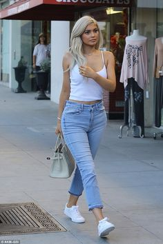 New bling! Kylie Jenner showed off her new diamond necklace dedicated to Tyga as they headed for a lunch date in LA