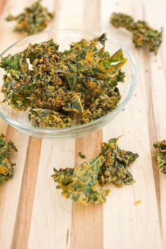 "Vegan cheesy kale chips. Taking note of this commentor tip - ""I make kale chips often, and I don't have a dehyrator. I put my oven temp as low as it will go (mine goes to 170 F) and prop the door open and bake for about 1.5 hours. If you don't leave the door open, it holds the moisture in the oven and they won't dry out."""