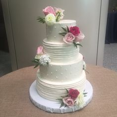 buttercream dots and ribbon lacing and fresh florals
