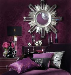 purple living room with accents of black, chrome, and silver
