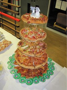 Not for my wedding, but good idea! Pizza cake w/ bride and groom topper...perfect for the midnight snack!